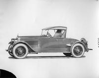 1923 Packard runabout, left side view, top raised, light in color