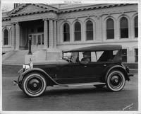 1924 Packard 226 sport model with Harlan Fengler at wheel in front of Bruce Dodson building