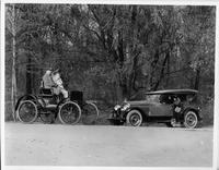 1924 Packard touring car and 1899 Packard model A on wooded road