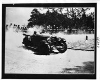 1924 Packard touring car rounding corner during a race