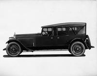 1924 Packard touring car, left side view, top raised, side curtains in place