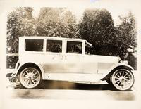 "1924 Packard sedan, right side view, parked on street, ""H"" on monogram panel"