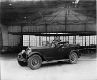 1924 Packard touring car with Army lieutenants in airplane hanger