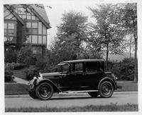 1925 Packard left side view, parked on residential street, large home in background
