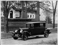1927 Packard club sedan, three-quarter left front view, parked on street in front of brick house