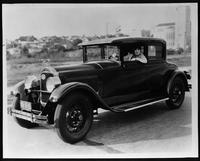 1927 Packard coupe, three-quarter left front view, actress Pauline Starke behind wheel