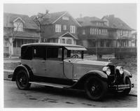 1927 Packard two-toned special berline, parked on residential street