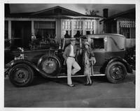 1927 Packard stationary town cabriolet with actors Neil Hamilton and Olive Borden