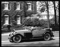 1927 Packard phaeton, two trunks on running board, parked in front of house