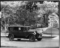 1927 Packard sedan, three-quarter right front view, parked on residential street