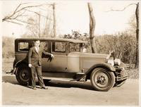 1927 Packard sedan, owner N.S. Murphey of Milwaukee standing at passenger door