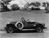 1927 Packard runabout, right side view, top lowered, male behind wheel
