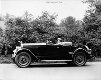 1927 Packard runabout, right side view, top lowered, owner Miss Marjorie Dork behind wheel