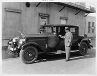 1927 Packard coupe, three-quarter left front view, owner Louis B. Mayer standing at driver's door