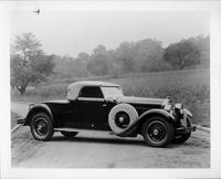 1928 Packard roadster, seven-eights right front view, top raised, parked on country road