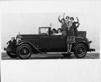 1928 Packard convertible coupe with six women