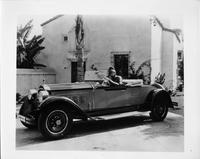 1928 Packard runabout, male dressed in armor behind wheel