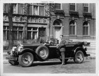 1928 Packard touring car, actor Alexander Gray standing at driver's door