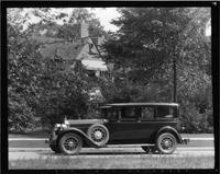 1928 Packard inside drive limousine, seven-eights left front view, on residential street