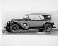 1928 Packard touring car, five-sixth left side view, top raised, side mounted spare tire with fitted cover