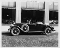 1929 Packard runabout, right side view, top folded, parked on street