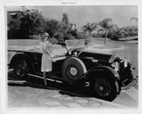 1929 Packard runabout, actress Raquel Torres standing on running board