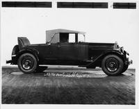 1929 Packard convertible coupe, right side view, top raised, rumble seat open