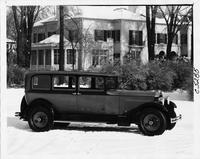 1930 Packard sedan, right side view, parked on snowy street, in front of house