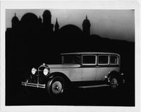 1930 Packard sedan, three-quarter right front view, domed building in background