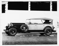 1930 Packard two-toned touring car, nine-tenths left side view, top raised