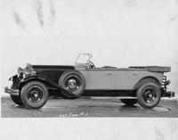 1930 Packard two-toned touring car, nine-tenths left side view, top folded