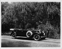 1930 Packard touring car, three-quarter right side view, top folded, parked on country road
