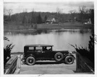1930 Packard sedan limousine parked at water's edge