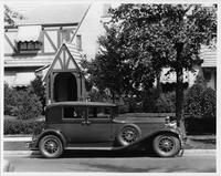 1930 Packard club sedan, right side view, parked on street in front of home