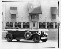1930 Packard phaeton parked in front of Grosse Pointe Yacht Club