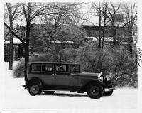 1930 Packard sedan, nine-tenths right side view, parked in snow