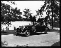 1932 Packard coupe roadster, top folded, parked by gate at Packard Proving Grounds