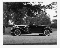 1932 Packard coupe roadster, left side view, top folded, female driver and passenger