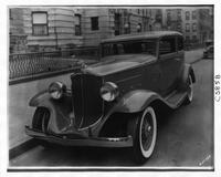 1932 Packard coupe sedan, three-quarter front view, parked on street