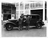 1932 Packard club sedan, left side view, two men standing at driver's door