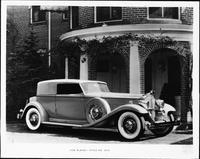 1932 Packard convertible victoria parked in front of brick portico
