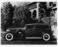 1932 Packard touring car, left side view, top raised, parked in drive
