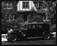 1932 Packard sedan, left side view, parked on street in front of house