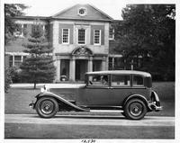 1932 Packard sedan, left side view, parked on drive in front of house, male driver