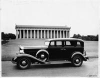 1932 Packard sedan, parked in front of a reproduction of the Parthenon