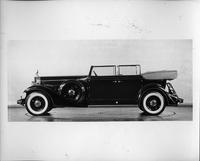 1933 Packard convertible sedan, left side view, top folded, windows rolled up