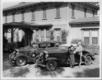 1934 Packards parked in driveway of California home