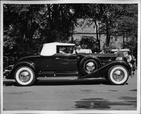 1934 Packard coupe roadster, right side view, top raised, parked on street