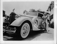 1934 Packard coupe roadster, blonde woman in bathing suit at driver's door