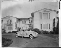 1934 Packard coupe roadster parked in driveway of Miss Arline Judge's home